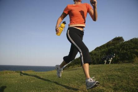 Exercise outside instead of using a treadmill - Use less electricity - Image courtesy of http://drblessyl.files.wordpress.com/2009/04/running-outside-with-waterbottle1.jpg?w=444&h=268